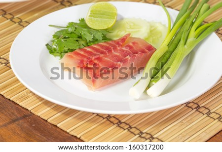 Salmon flesh and vegetables