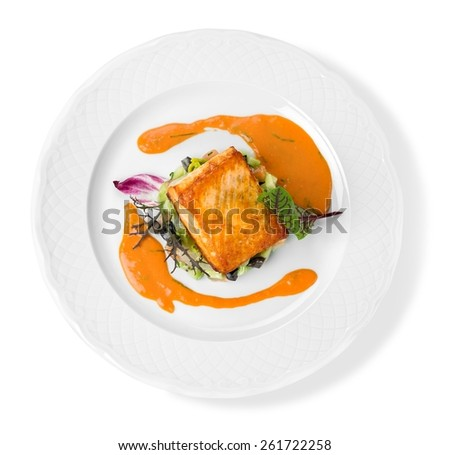 Salmon. Grilled Salmon Steak  with Spinach, Tartare Cream and Lemon Wedges - stock photo