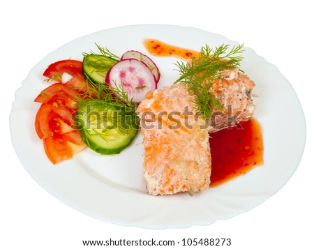 salmon in creamy sauce with vegetables on a white background