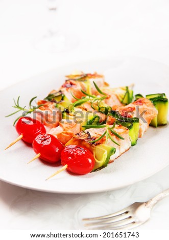 salmon kebab: skewers with salmon, cherry tomatoes and zucchini