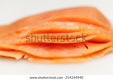 Salmon on white board for sushi preparation. Delicious fresh fish. Healthy and tasty - stock photo