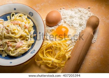 salmon pasta with homemade pasta ingredients - stock photo