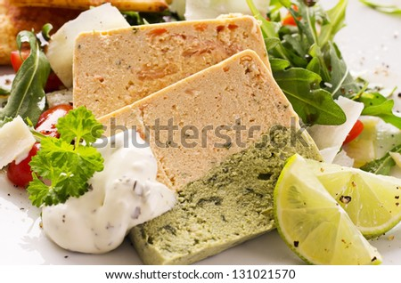 salmon pastete with rocket salad - stock photo