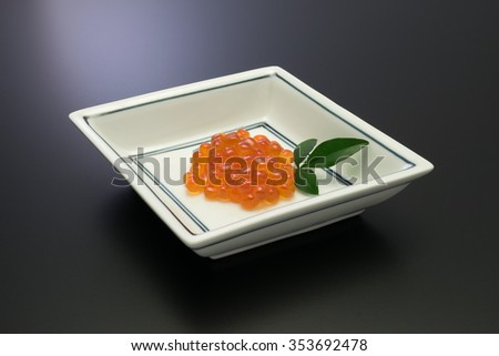 salmon roe. in Japan, salmon roe is called as Ikura and recognized as one of the luxury food stuffs. it is served for the festive meals such as New Year celebration cuisine.  - stock photo
