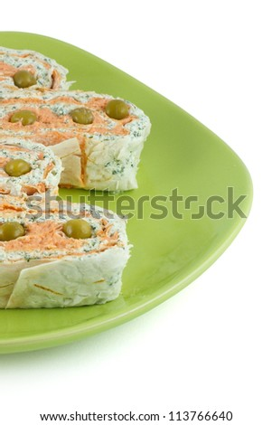 Salmon roll and cheese on a green plate isolated on a white background - stock photo