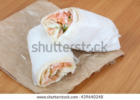 Salmon roll with salad leaves in bread