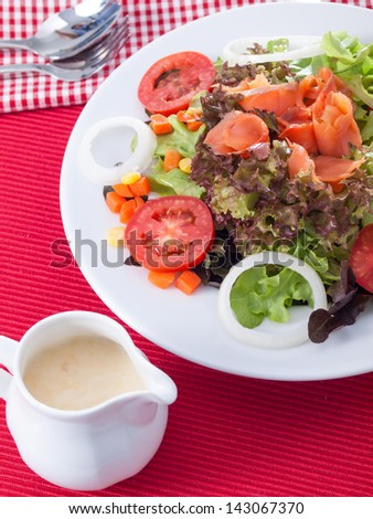salmon salad and source - stock photo