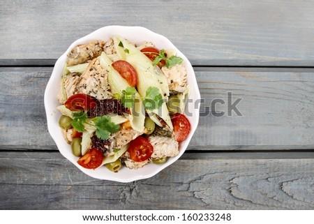 Salmon salad on wooden table - stock photo