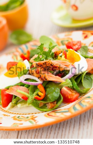 salmon salad with egg and vegetables - stock photo