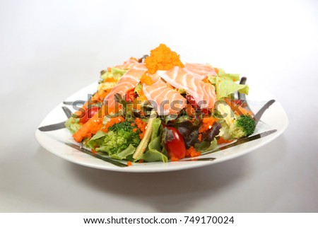 Salmon Salada with white background. Japanese food and dinner.