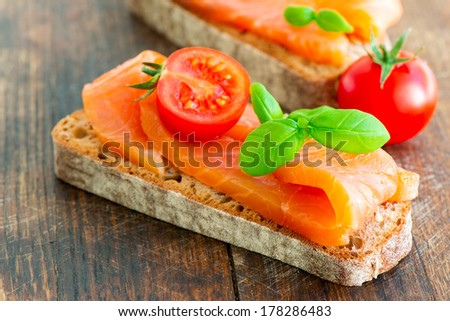 Salmon Sandwich with basil and slice of fresh tomato