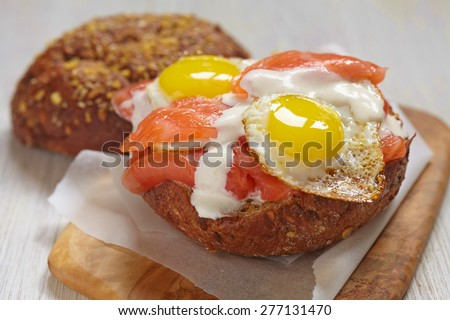 Salmon sandwich with fried eggs and mayo - stock photo