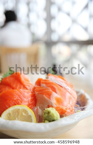 salmon sashimi on wood background japanese food