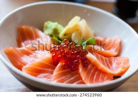 salmon sashimi put into white bowl - stock photo