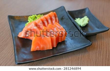 Salmon sashimi served with wasabi - stock photo