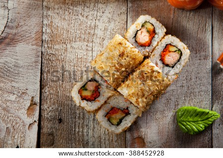 Salmon Skin Maki Sushi - Roll with Salmon Skin, Cucumber and Avocado inside. Grilled Salmon Skin outside - stock photo