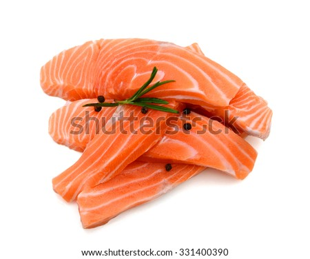 salmon slices with raw peppers and spice on white background  - stock photo