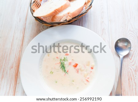 salmon soup served with bread  - stock photo
