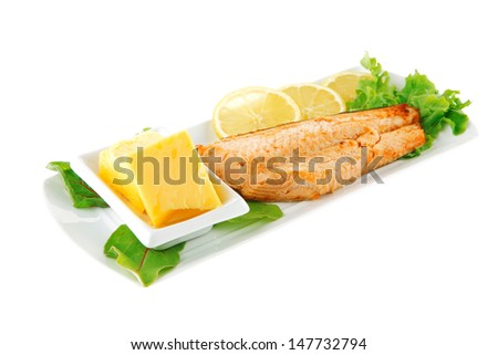 salmon steak and butter with green salad - stock photo