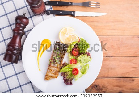 Salmon steak food prepare for serve to customer.