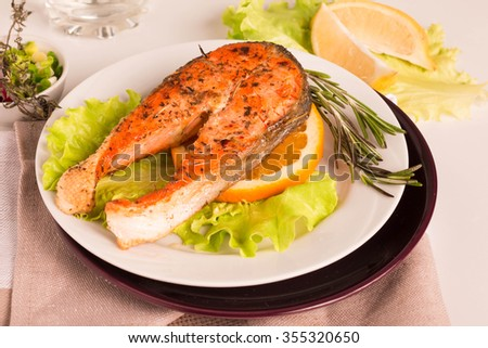 Salmon Steak. Grilled Salmon with Fresh Salad Leaf and orange. Selective Focus.