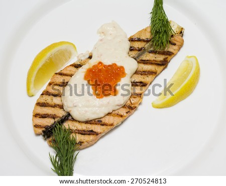 Salmon steak grilled with shrimp sauce and red caviar