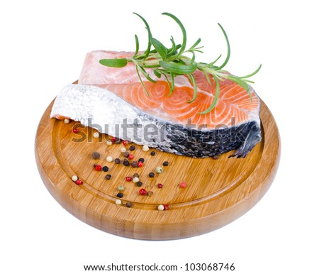 Salmon steak on a wooden board isolated