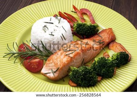 Salmon steak red fish with rice garnish - stock photo
