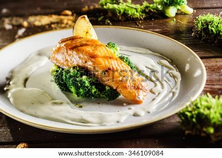 salmon steak with broccoli - stock photo