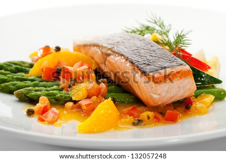 Salmon Steak with Fruits, Vegetables, Asparagus and Lemon - stock photo