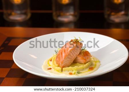 Salmon steak with mashed potatoes on bar background - stock photo
