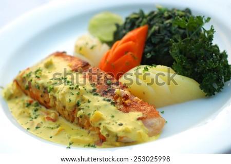 Salmon steak with mmustard cream sauce - stock photo