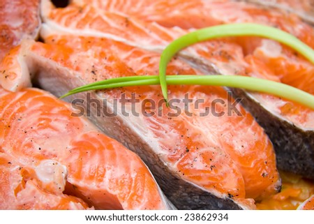 salmon steak with onion, prepared for roasting