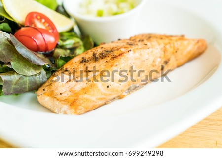 salmon steak with salad and apple cream sauce