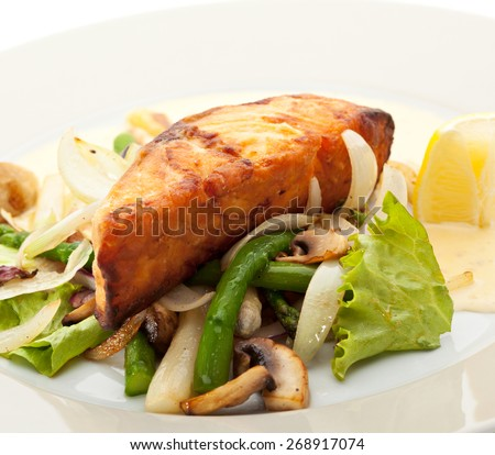 Salmon Steak with Vegetables and Sauce - stock photo