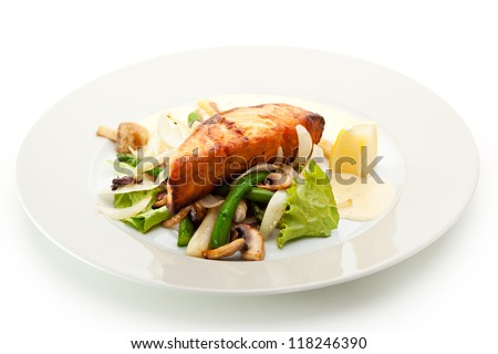 Salmon Steak with Vegetables, Asparagus, Lemon, Onions, Mushrooms and Sauce