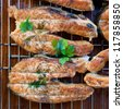 salmon steaks grilled and decorated with parsley - stock photo