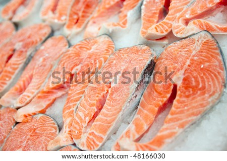 Salmon steaks on cooled market display, closeup shot - stock photo