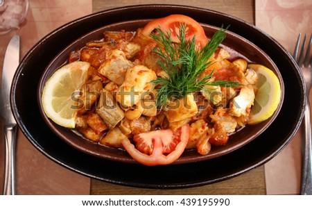 Salmon stew (Turkish: Somon Guvec) on the dinner plate - stock photo