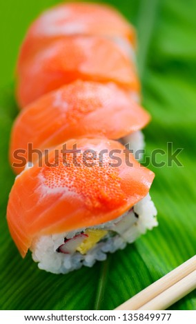 salmon sushi on green leaf