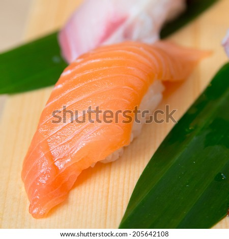 Salmon Sushi on wooden plate decoration - stock photo