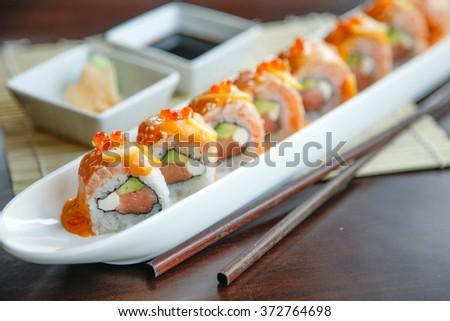 Salmon sushi rolls set. - stock photo