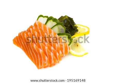 Salmon sushi sashimi isolated on white background. Macro. - stock photo