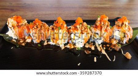 Salmon Sushi, with Selective focus, isolated on wooden table - stock photo