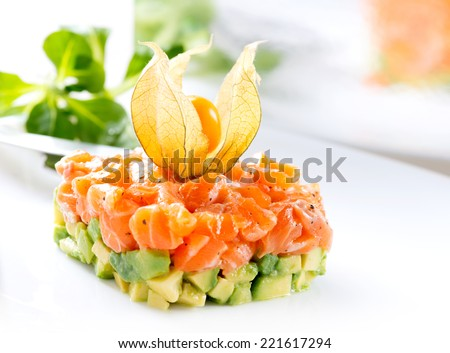 Salmon Tartar over White Background. Gourmet Food. Starter closeup - stock photo