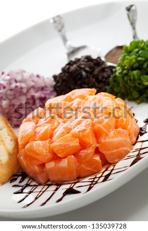 Salmon Tartare with Crispy Bread and Sliced Onions - stock photo