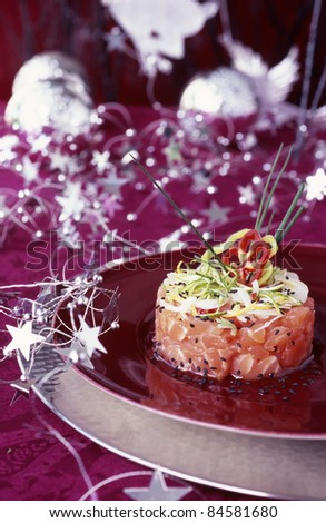 Salmon tartare with lime and black sesame seeds - stock photo