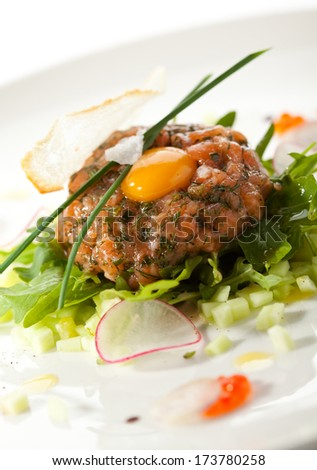 Salmon Tartare with Quail Egg and Rucola