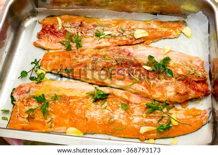 Salmon trout ready to be cooked in the oven