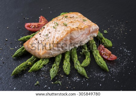 salmon with green asparagus - stock photo
